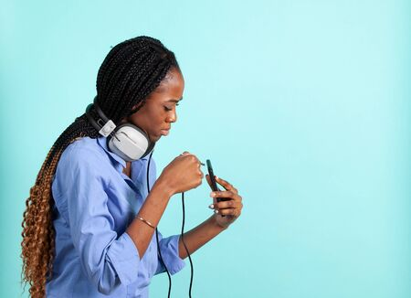 African American young woman with retro wired head phones.