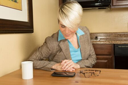 Young attractive businesswoman in a hotel with a coffee mug