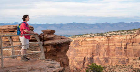 Woman standing on the edge of an overlook