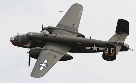Monroe, North Carolina - November 4, 2012:  World War II B-25 Mitchell Bomber Performing during Warbirds Over Monroe Air Show in Monroe, NC, on November 4, 2012.