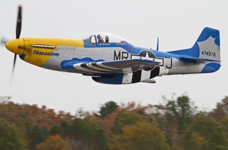 Monroe, North Carolina - November 4, 2012:  World War II P-51 Mustang Fighter Performing during Warbirds Over Monroe Air Show in Monroe, NC, on November 4, 2012.