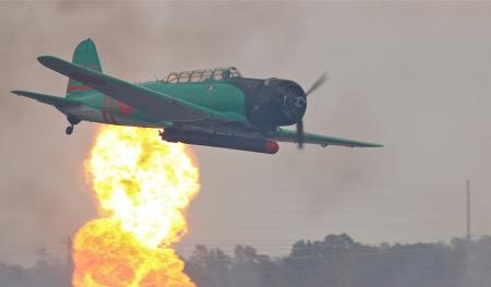 Monroe, North Carolina - November 4, 2012:  Reenactment of Japanese Attack on Pearl Harbor during Warbirds Over Monroe Air Show in Monroe, NC, on November 4, 2012. 新闻类图片