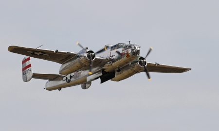 Monroe, North Carolina - November 4, 2012:  World War II B-25 Mitchell Bomber Performing during Warbirds Over Monroe Air Show in Monroe, NC, on November 4, 2012. Stock Photo - 18673576