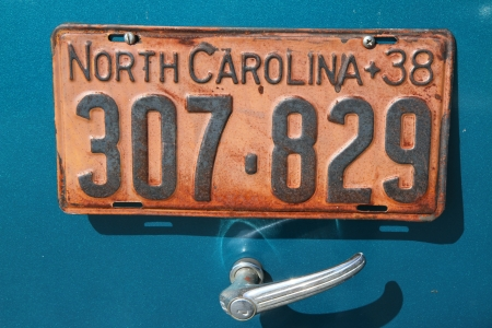 Concord, North Carolina - September 22, 2012:  A license plate on an antique automobile on display at the Charlotte AutoFair classic car show at Charlotte Motor Speedway, September 22, 2012.