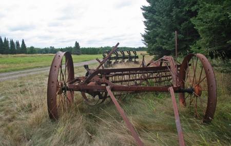 farm equipment: Old farm equipment abandoned in a field