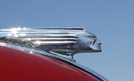 Concord, North Carolina - April 6, 2013:  Hood ornament of a 1939 Pontiac automobile on display at the Food Lion Auto Fair classic car show at Charlotte Motor Speedway in Concord, North Carolina.