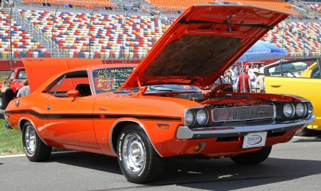 challenger: Concord, North Carolina - April 6, 2013:  A 1970 Dodge Challenger automobile on display at the Food Lion Auto Fair classic car show at Charlotte Motor Speedway in Concord, North Carolina.