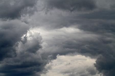 high winds: High winds swirl the dark clouds of an approaching storm