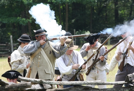 armaments: Rock Hill, South Carolina -  July 11, 2009:  Revolutionary War reenactors recreate the Battle of Hucks Defeat, fought on July 12, 1780, on the grounds of Historic Brattonsville in South Carolina.
