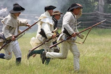 flint gun: Rock Hill, South Carolina -  July 11, 2009:  Revolutionary War reenactors recreate the Battle of Hucks Defeat, fought on July 12, 1780, on the grounds of Historic Brattonsville in South Carolina.