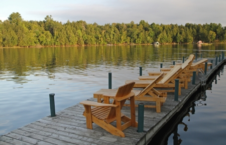 Lounge chairs on a pier on a wilderness lake Stock Photo - 22437563