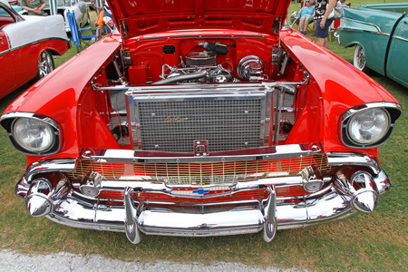 bel air: CONCORD, NC - SEPTEMBER 21   Engine compartment of a 1957 Chevy Bel Air on display at the Charlotte AutoFair classic car show at Charlotte Motor Speedway in Concord, North Carolina, September 21, 2013