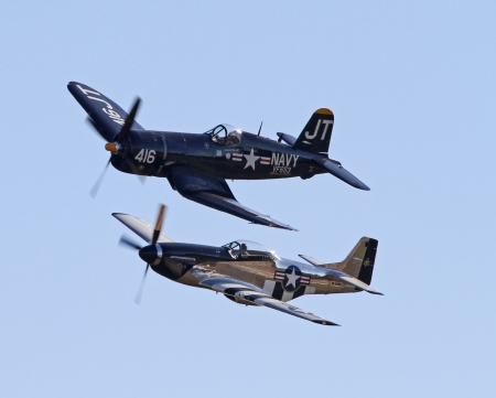 Monroe, North Carolina - November 10, 2013 - A World War II P-51 Mustang and Corsair Fighter Performing during Warbirds Over Monroe Air Show in Monroe, NC