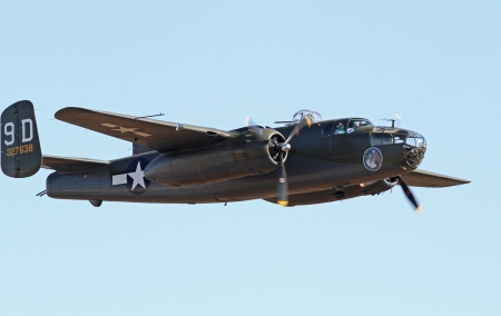 war bird: Monroe, North Carolina - November 10, 2013 - World War II B-25 Mitchell Bomber Performing during Warbirds Over Monroe Air Show in Monroe, NC