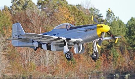 Monroe, North Carolina - November 10, 2013 - World War II P-51 Mustang Fighter Performing during Warbirds Over Monroe Air Show in Monroe, NC