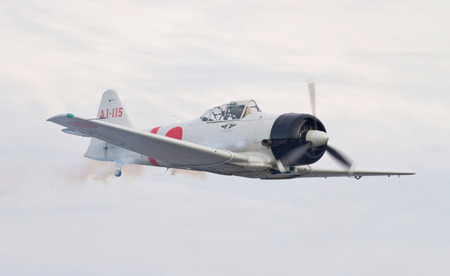 war bird: MONROE, NC -- NOVEMBER 8, 2014:  Reenactment of the Japanese Attack on Pearl Harbor during Warbirds Over Monroe Air Show in Monroe, NC. Editorial