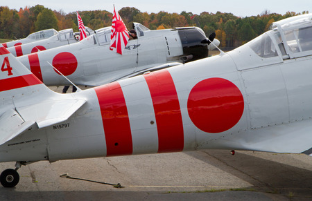 MONROE, NC -- NOVEMBER 8, 2014:  Aircraft  that will Reenact the Japanese Attack on Pearl Harbor  on display during Warbirds Over Monroe Air Show in Monroe, NC.