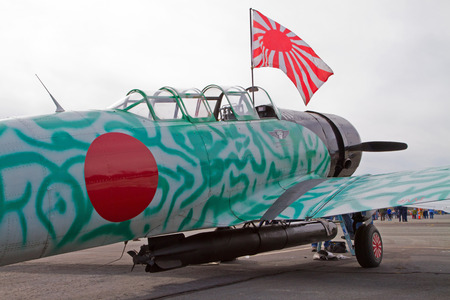 reenact: MONROE, NC -- NOVEMBER 8, 2014:  An Aircraft that will Reenact the Japanese Attack on Pearl Harbor on display during Warbirds Over Monroe Air Show in Monroe, NC. Editorial