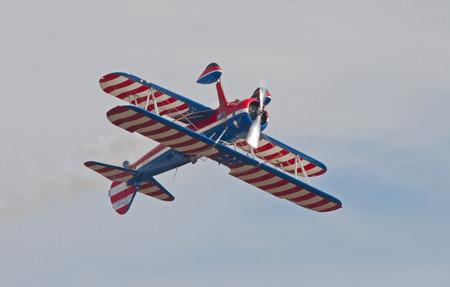 warbirds: MONROE, NC -- NOVEMBER 8, 2014:  An Aerobatic Bi-Plane Performing  at the Warbirds Over Monroe Air Show in Monroe, NC.
