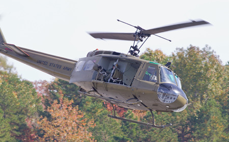warbirds: MONROE, NC -- NOVEMBER 8, 2014:  A UH-1H Huey Helicopter Performing at the Warbirds Over Monroe Air Show in Monroe, NC. Editorial