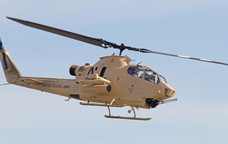 warbirds: MONROE, NC -- NOVEMBER 8, 2014:  An AH-1 Cobra Helicopter Performing at the Warbirds Over Monroe Air Show in Monroe, NC.