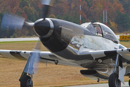 warbirds: MONROE, NC -- NOVEMBER 8, 2014:  A P-51 Mustang Fighter Performing at the Warbirds Over Monroe Air Show in Monroe, NC. Editorial