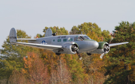 warbirds: MONROE, NC -- NOVEMBER 8, 2014:  A C-45 Expeditor Aircraft Performing at the Warbirds Over Monroe Air Show in Monroe, NC. Editorial