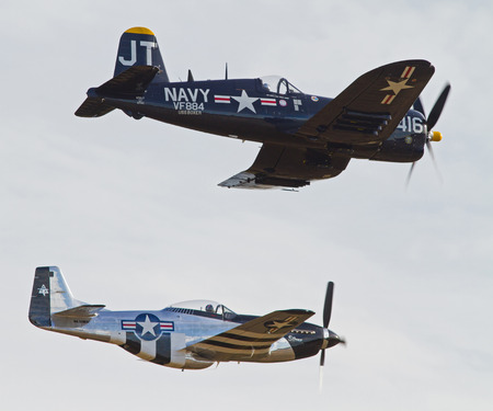 warbirds: MONROE, NC -- NOVEMBER 8, 2014:  A Corsair and P-51 Mustang Fighter Performing at the Warbirds Over Monroe Air Show in Monroe, NC. Editorial