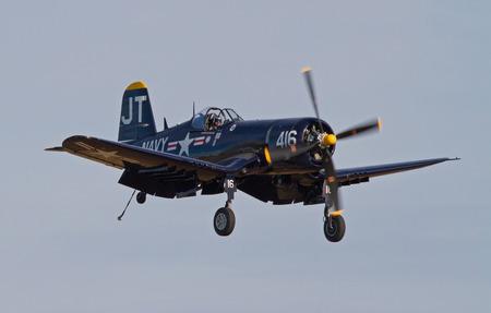 warbirds: MONROE, NC -- NOVEMBER 8, 2014:  A Corsair Fighter Aircraft Performing at the Warbirds Over Monroe Air Show in Monroe, NC. Editorial