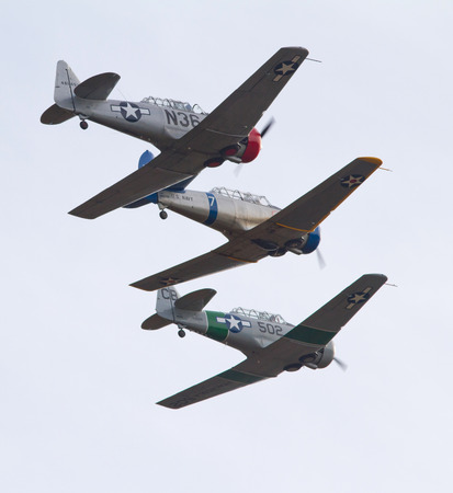 texan: MONROE, NC -- NOVEMBER 8, 2014:  Three T-6 Texan Aircraft Performing at the Warbirds Over Monroe Air Show in Monroe, NC.