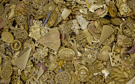 A jumble of antique brass jewelry.