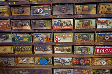drawers: CHARLOTTE, NC - FEBRUARY 7, 2015:  Antique store cabinet with cigar advertising for sale at the Metrolina Expo Antique Show. Editorial