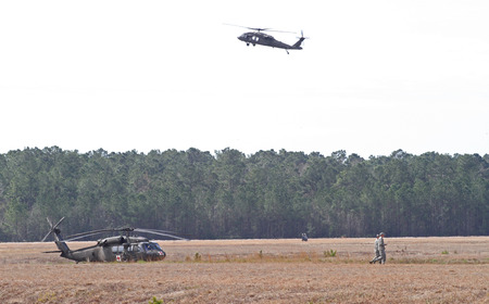 blackhawk helicopter: GEORGETOWN, SC - March 8, 2015:  A U.S. Army National Guard Blackhawk helicopter hovers over a military encampment during Operation Vigilant Guard, a disaster drill simulating a Category 4 hurricane making landfall on the South Carolina coast.