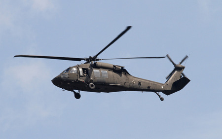 blackhawk helicopter: GEORGETOWN, SC - March 9, 2015:  A U.S. Army National Guard Blackhawk helicopter hovers overhead during Operation Vigilant Guard, a disaster drill simulating a Category 4 hurricane making landfall on the South Carolina coast.