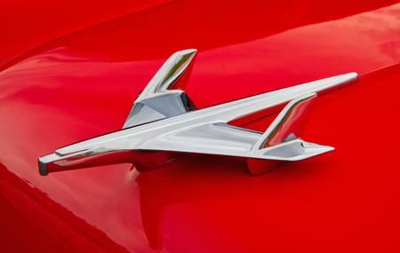 CONCORD, NC -- APRIL 11, 2015:  Close up of a 1955 Chevy hood ornament on display at the Charlotte AutoFair classic car show held at Charlotte Motor Speedway.