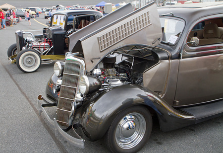 highboy: CONCORD, NC -- APRIL 11, 2015:  Two 1930s Ford hot rod automobiles on display at the Charlotte AutoFair classic car show held at Charlotte Motor Speedway. Editorial