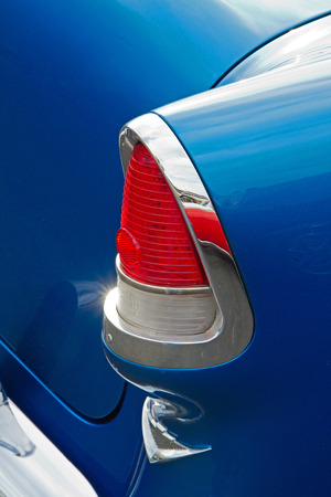 CONCORD NC - APRIL 11 2015:  Close up of a 1955 Chevy automobile tail light on display at the Charlotte AutoFair classic car show held at Charlotte Motor Speedway. Editorial