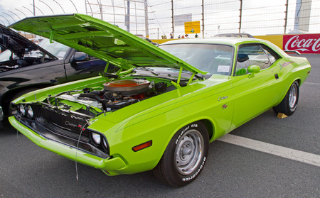 restoring: CONCORD NC - APRIL 11 2015:  A 1970 Dodge Challenger automobile on display at the Charlotte AutoFair classic car show held at Charlotte Motor Speedway.
