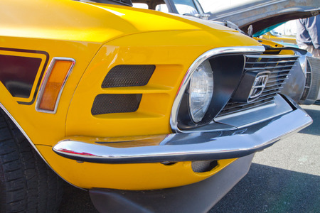 mach: CONCORD, NC - APRIL 11, 2015:  A 1970 Ford Mustang Mach 1 automobile on display at the Charlotte AutoFair classic car show held at Charlotte Motor Speedway.