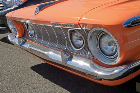 fury: CONCORD NC - APRIL 11 2015:  A 1962 Plymouth Fury automobile on display at the Charlotte AutoFair classic car show held at Charlotte Motor Speedway.