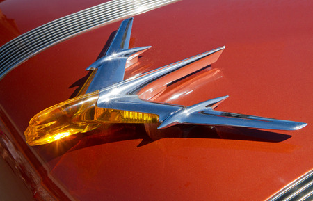 chieftain: CONCORD NC - APRIL 11 2015:  Hood ornament of a 1955 Pontiac Chieftain automobile on display at the Charlotte AutoFair classic car show held at Charlotte Motor Speedway.