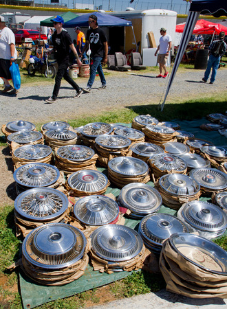 CONCORD NC - APRIL 11 2015:  Automobile hub caps for sale at the Charlotte AutoFair classic car show held at Charlotte Motor Speedway.