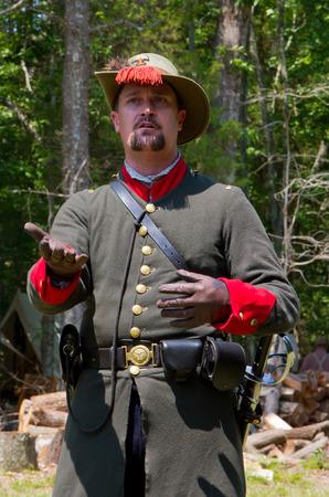 reenactor: HUNTERSVILLE NC  JUNE 6 2015:  A reenactor in a Confederate army uniform at an American Civil War battle reenactment at Historic Latta Plantation.