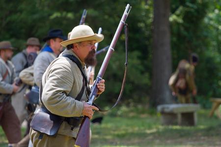 yankees: HUNTERSVILLE NC  JUNE 6 2015:  Closeup of a reenactor in a Confederate army uniform at an American Civil War battle reenactment at Historic Latta Plantation.