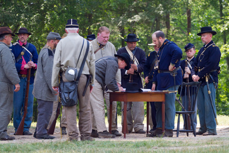 recreate: HUNTERSVILLE NC  JUNE 6 2015:  Reenactors recreate the signing of parole papers as part of a Confederate surrender during an American Civil War reenactment at Historic Latta Plantation.