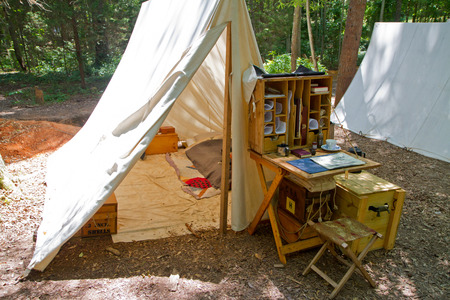 armaments: HUNTERSVILLE NC  JUNE 6 2015:  Example of a Civil Warera military tent on display during an American Civil War battle reenactment at Historic Latta Plantation.