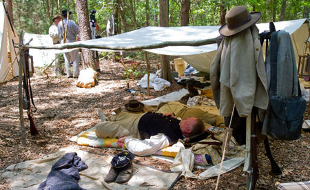yankees: HUNTERSVILLE NC  JUNE 6 2015:  Example of a Confederate camp shelter or shebang on display during an American Civil War battle reenactment at Historic Latta Plantation.