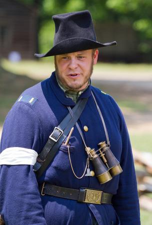 yankees: HUNTERSVILLE NC  JUNE 6 2015:  Reenactor in a Union army uniform participating in an American Civil War battle reenactment at Historic Latta Plantation.