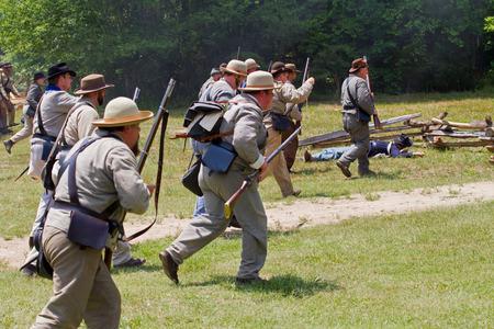 yankees: HUNTERSVILLE NC  JUNE 6 2015:  Reenactors in Confederate uniforms recreate an American Civil War battle at Historic Latta Plantation. Editorial