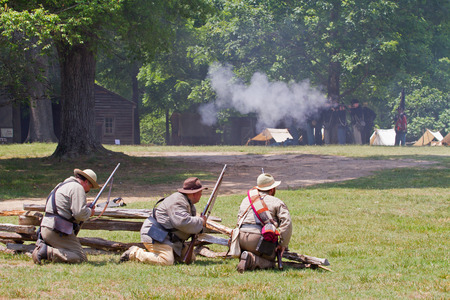 yankees: HUNTERSVILLE NC  JUNE 6 2015:  Reenactors in Confederate and Union army uniforms recreate an American Civil War battle at Historic Latta Plantation. Editorial